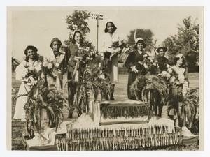 "Group portrait of women on a podium. Written on verso: ""Morris Brown Homecoming Queens- 1952; Left to Right- Annie Ragin- Miss Sigma; Margaret Hawkins- Miss Omega; Viola Kitter - Miss Freshman; Eloise Manse- Miss Morris Brown. Wilhemina Goodely- Miss Sophomore; Anna Jackson- Miss Alpha; Jacqueline Lightey- Miss Kappa""."