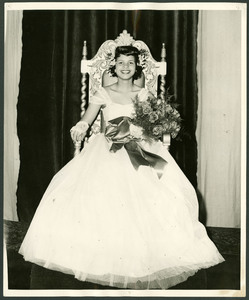 Homecoming 1948 Miss Clark-Mildred Brawner is seated on a throne wearing a white dress and holding a bouquet of flowers