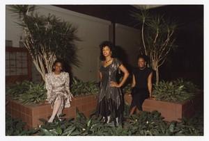 "Outdoor group portrait of three women standing. Written on verso: ""Miss Morris Brown College + Court 1988; L to R Pamela L. Daniels, Juliette Burgess, Connie F. Spencer""."