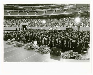 View from stage of audience and graduates at commencement.