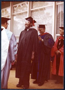 An unidentified man is hooded by Dean Wilkerson of Turner School of Theology.