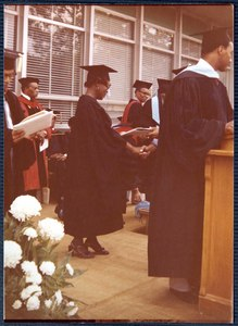 An unidentified woman receives a degree.