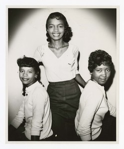 """Group portrait of three women. Written on verso: """"Homecoming Court ca. 1958, 1959; L to R Anne Bryant, Miss Freshman; Melbahn Ross, Miss Morris Brown; Jacqueline Price, Miss Sophomore""""."""