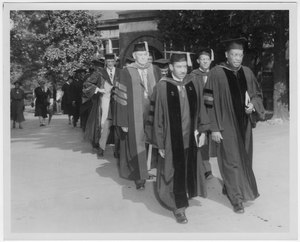 Dr. Harry Richardson walks in procession with other professors during commencement.