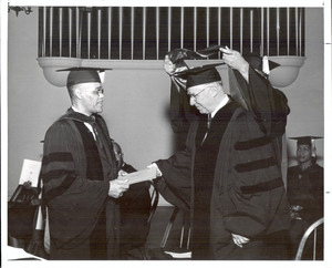 View of Rufus E. Clement shaking Mayor William B. Hartsfield's hand during graduation ceremony in 1961.