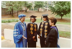 Written on verso: Spelman College; 1991; Commencement; L to R: President Johnnetta B. Cole, two students and Sharon Pratt Kelly, D.C. mayor, speaker.