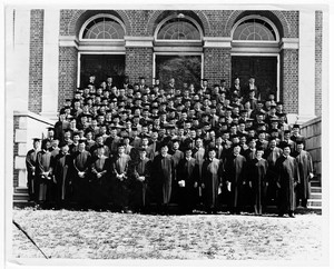 The graduating class of 1964 stand at the steps of an unidentified building for a class photo. Written on verso: Commencement at Southern Baptist Theological Seminary - May, 1964. Th.M. Degree James H. Costen - Back Floor Left.